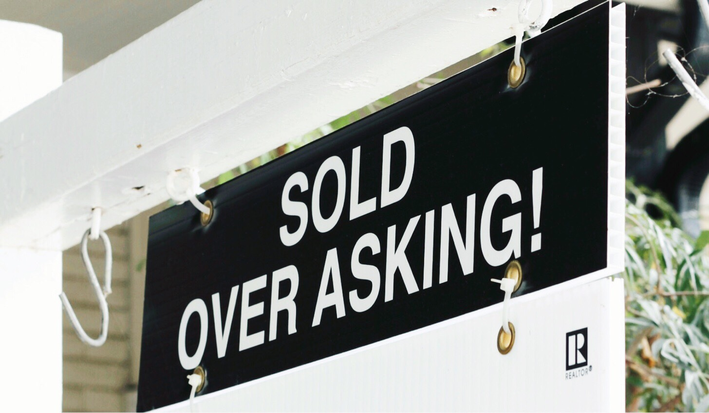 House sign with sold over asking rider.  Ford thurston and Chris Olsen Toronto housing market