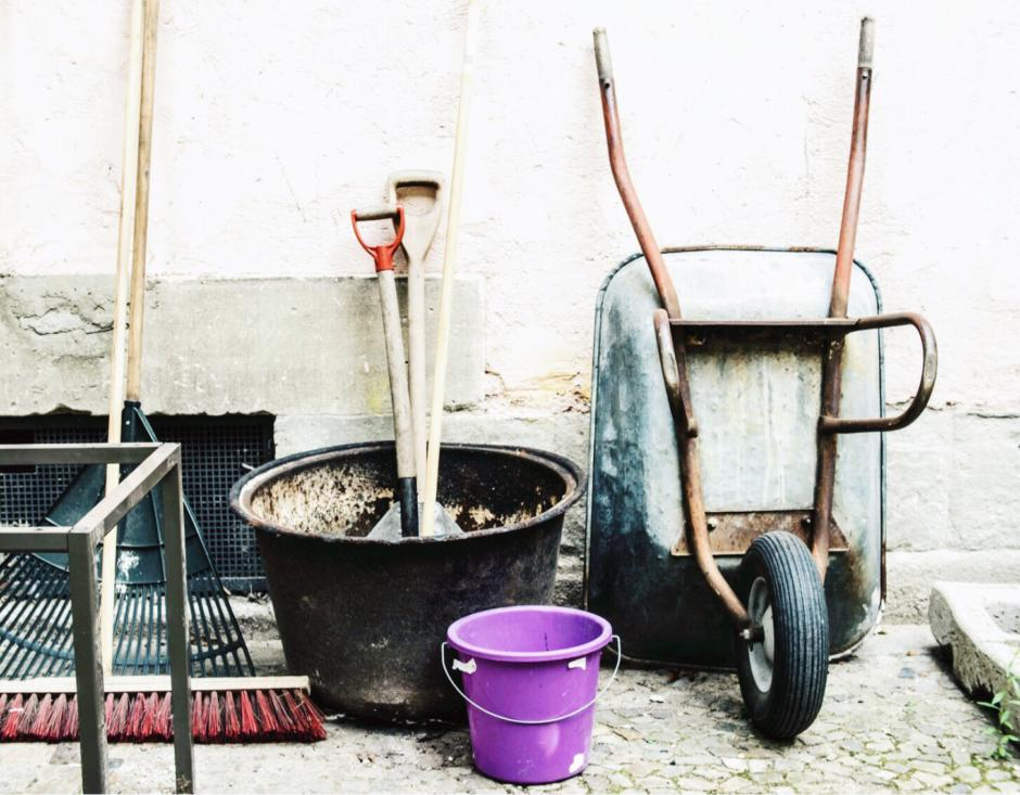 Garden tools leaning against a wall. 5 ways to increase your homes value