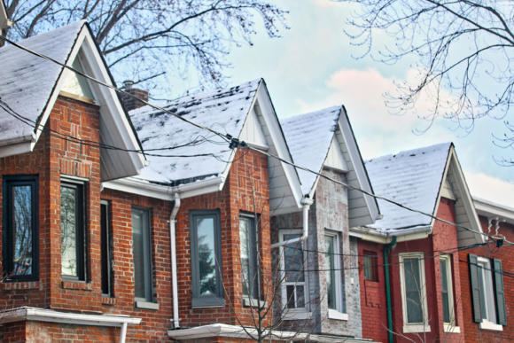 Toronto home prices rise in 2019. Snow covered rooftops of homes in Leslieville, Toronto