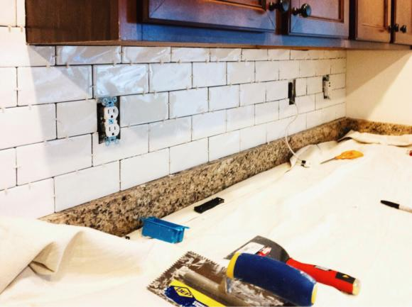 kitchen back splash being updated with white subway tiles. 5 ways to increase your homes value